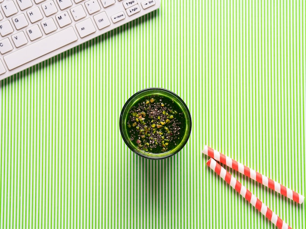 Green smoothie and white keyboard