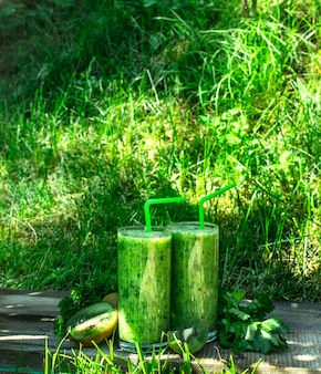 Green smoothie with parsley. on the summer background.