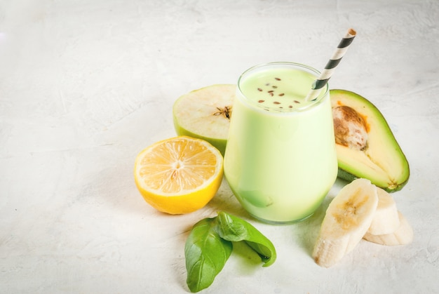 Green smoothies from yoghurt, avocado, banana, apple, spinach and lemon