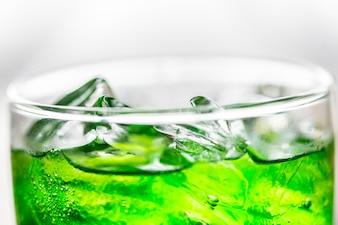 Green soda drink macro shot