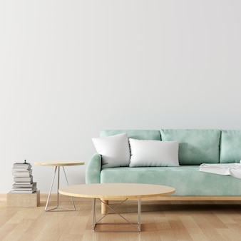 モックアップ用の空白のテーブルと白いリビングルームの緑のソファ