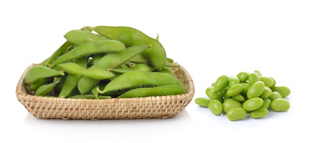 Green soybeans in the basket on white wall