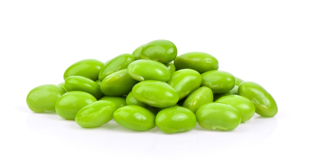 Green soybeans on white surface
