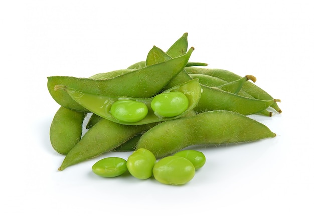Green soybeans on white wall