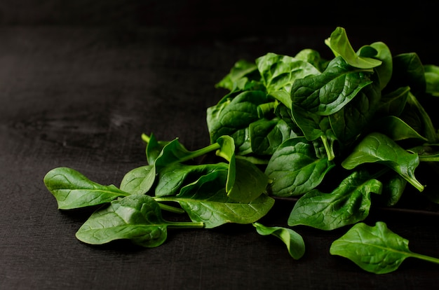 Green spinach on black background
