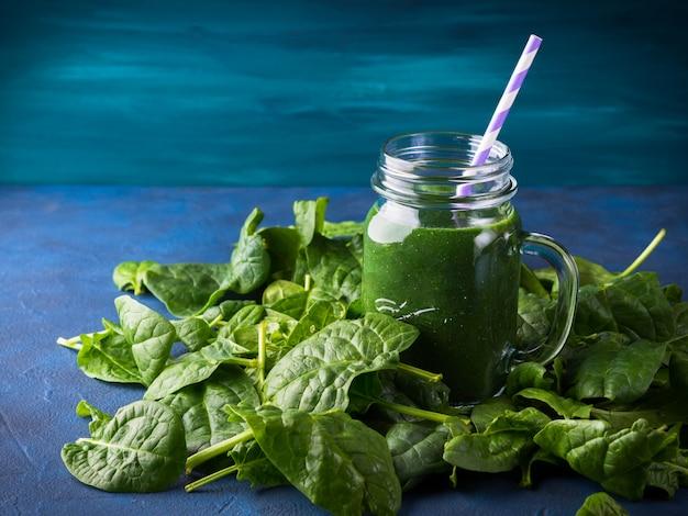 Green spinach spirulina smoothie in mason jar