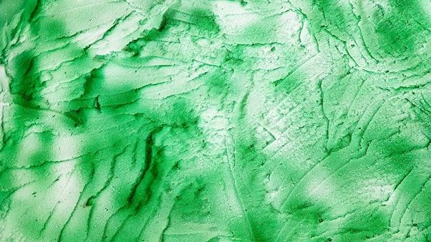 Green sponge texture. polystyrene foam texture background. old green foam rubber texture as background.