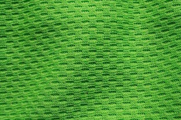 Green sports clothing fabric football shirt jersey texture close up