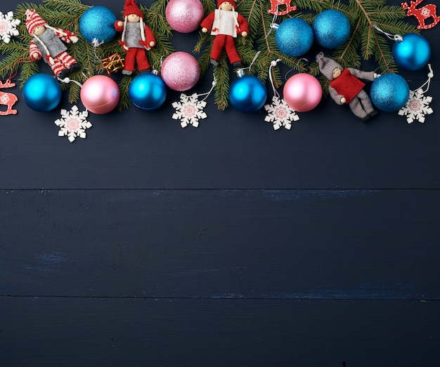 Green spruce branches and christmas blue and pink balls