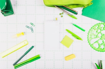 Green stationery around notepad