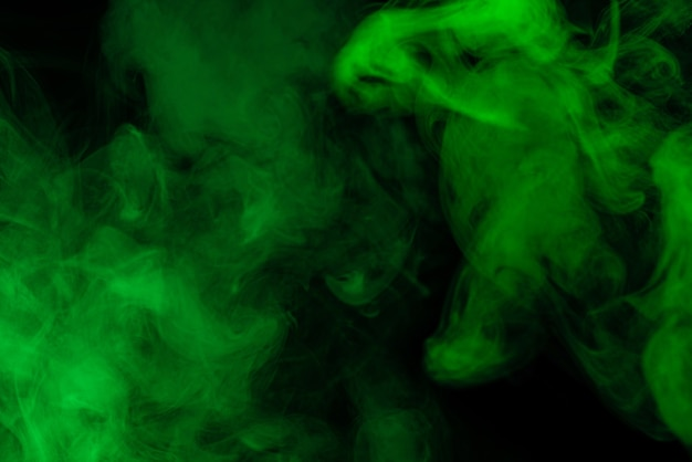 Green steam on a black background. copy space.