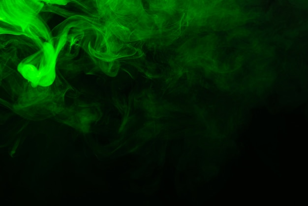 Green steam on a black background.