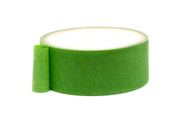 白い背景で隔離の緑の粘着テープ