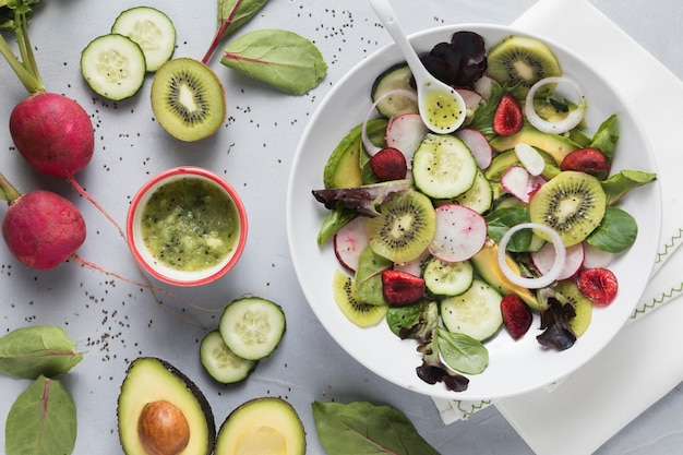 Green summer salad with veggies and fruit