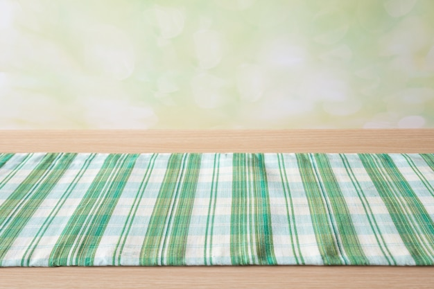 Green table cloth on wood table