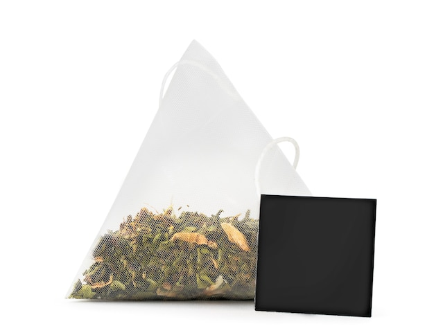 Green tea bag with tag close-up on white