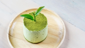 Green tea cake on the wood plate.