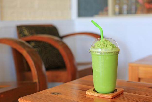 Green tea frappe on wood table