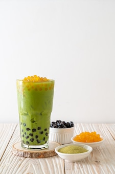 Green tea latte with bubble and honey bubbles