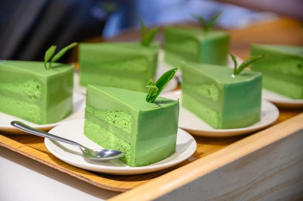 Green tea matcha cake slices with leaf
