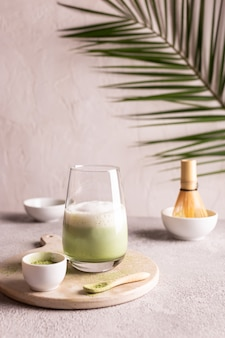 Green tea matcha latte on a white stone board