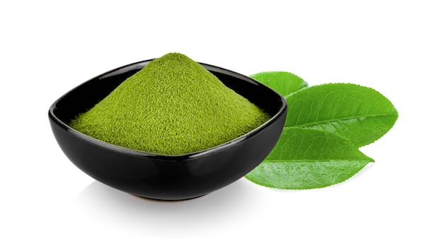 Green tea powder in a bowl isolated on white surface