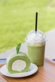 Green tea roll cake with tea leaves and iced green tea with milk green tea roll cake