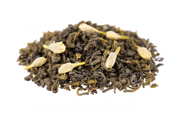 Green tea with jasmine, isolated. aromatic green dry tea, close up.