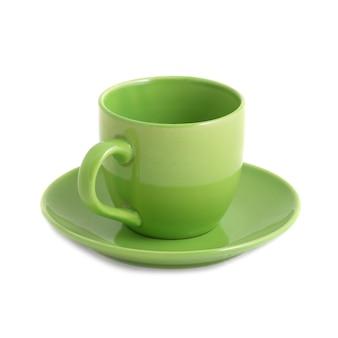 Зеленая чашка и блюдце изолированные