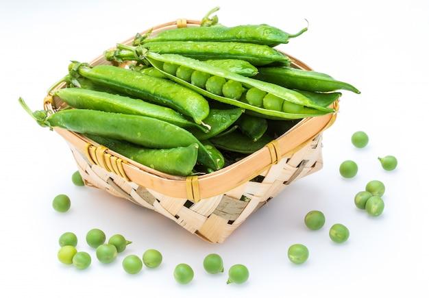 Green, tender, fresh and raw peas.
