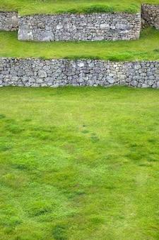 Green terraces at machu picchu in peru