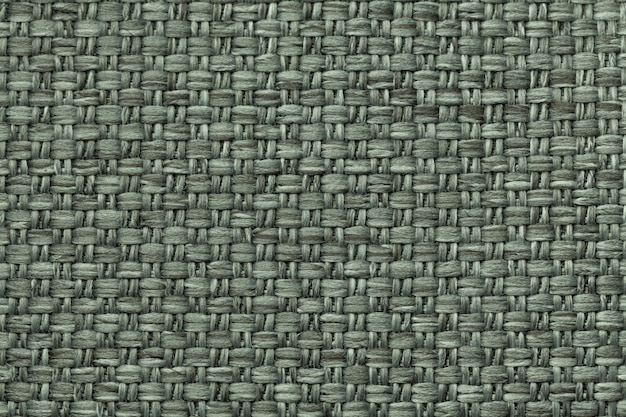 Green textile background with checkered pattern