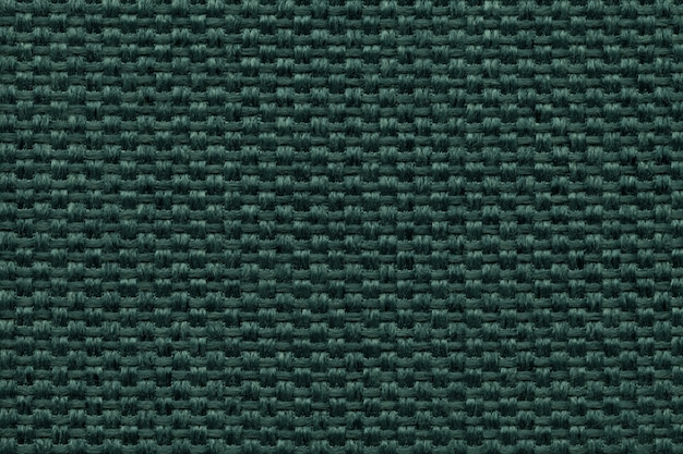 Green textile background with checkered patterno.