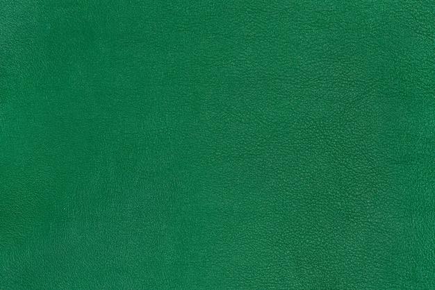 緑の質感の滑らかな革の表面の背景、小さな木目