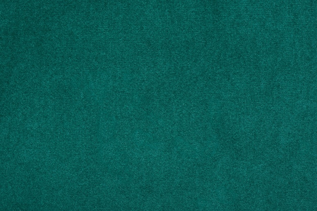 Green textured textile background, abstraction, close up