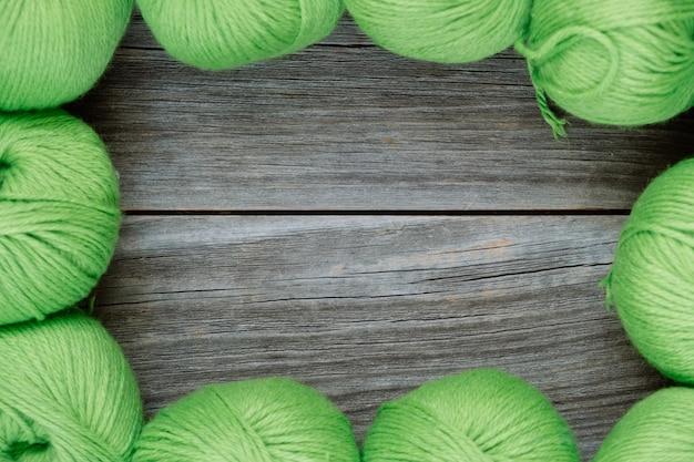 Green thread balls for needlework, frame background