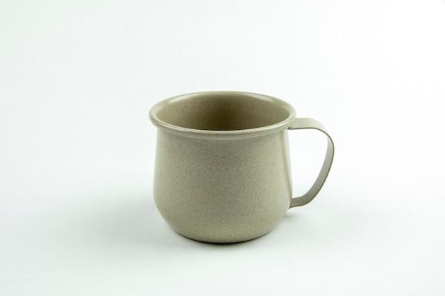 Green tin cup.