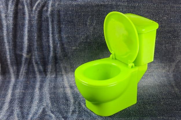 Green toilet bowl