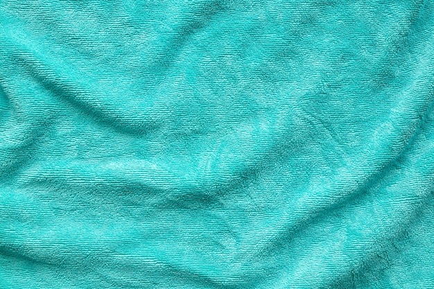 Green towel fabric texture surface close up background
