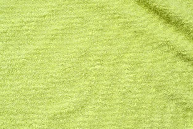 緑のタオル生地テクスチャ表面クローズアップ背景