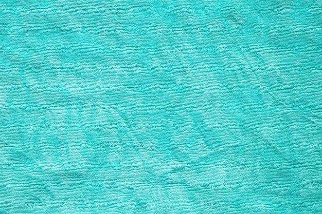 Зеленое полотенце ткань текстуры поверхности крупным планом фон