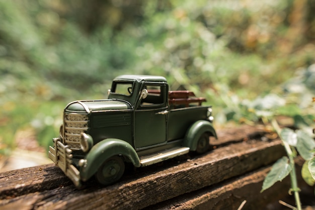 Green toy pickup truck on hand