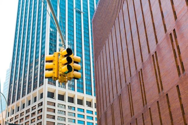 Green traffic light on city street.