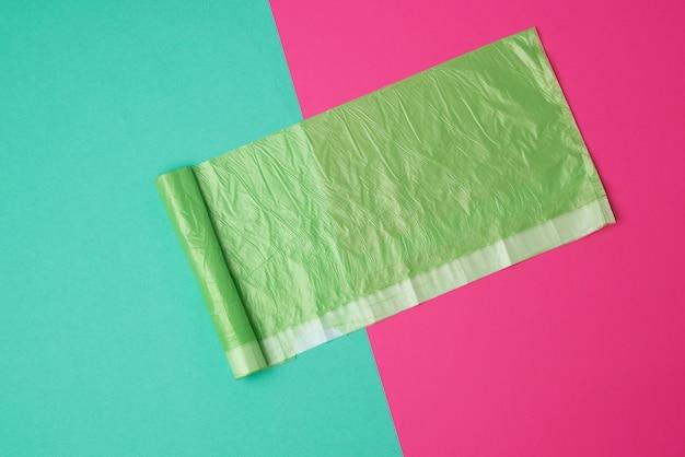 Green transparent plastic bag for garbage