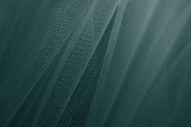緑のチュールのカーテンの織り目加工の背景