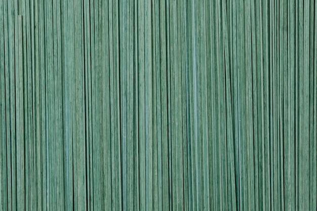 緑の未調理のタリアテッレテクスチャ背景