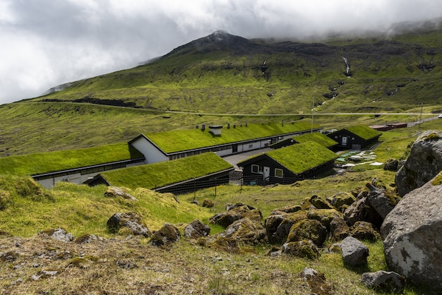 Green valley mjorkadalur on the faroese island