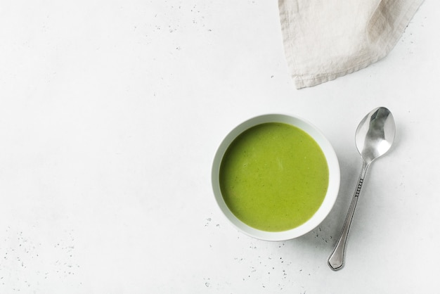 Green vegetable soup on white, top view