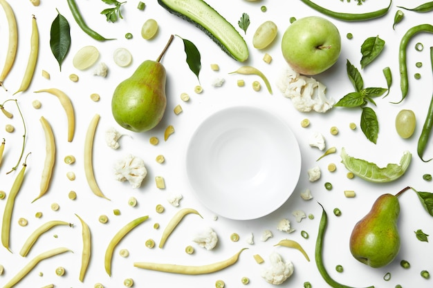 Green vegetables and fruits for white table. healthy eating and food for vegans