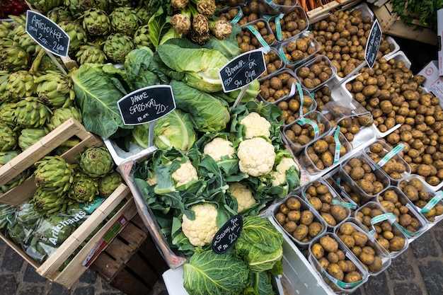Green vegetables and potatoes at market